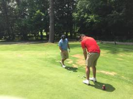 Brandon Paternoster (left) and Wes Graham (Right) talking putting strategy